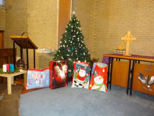 Some of the bags of gifts round the tree 1